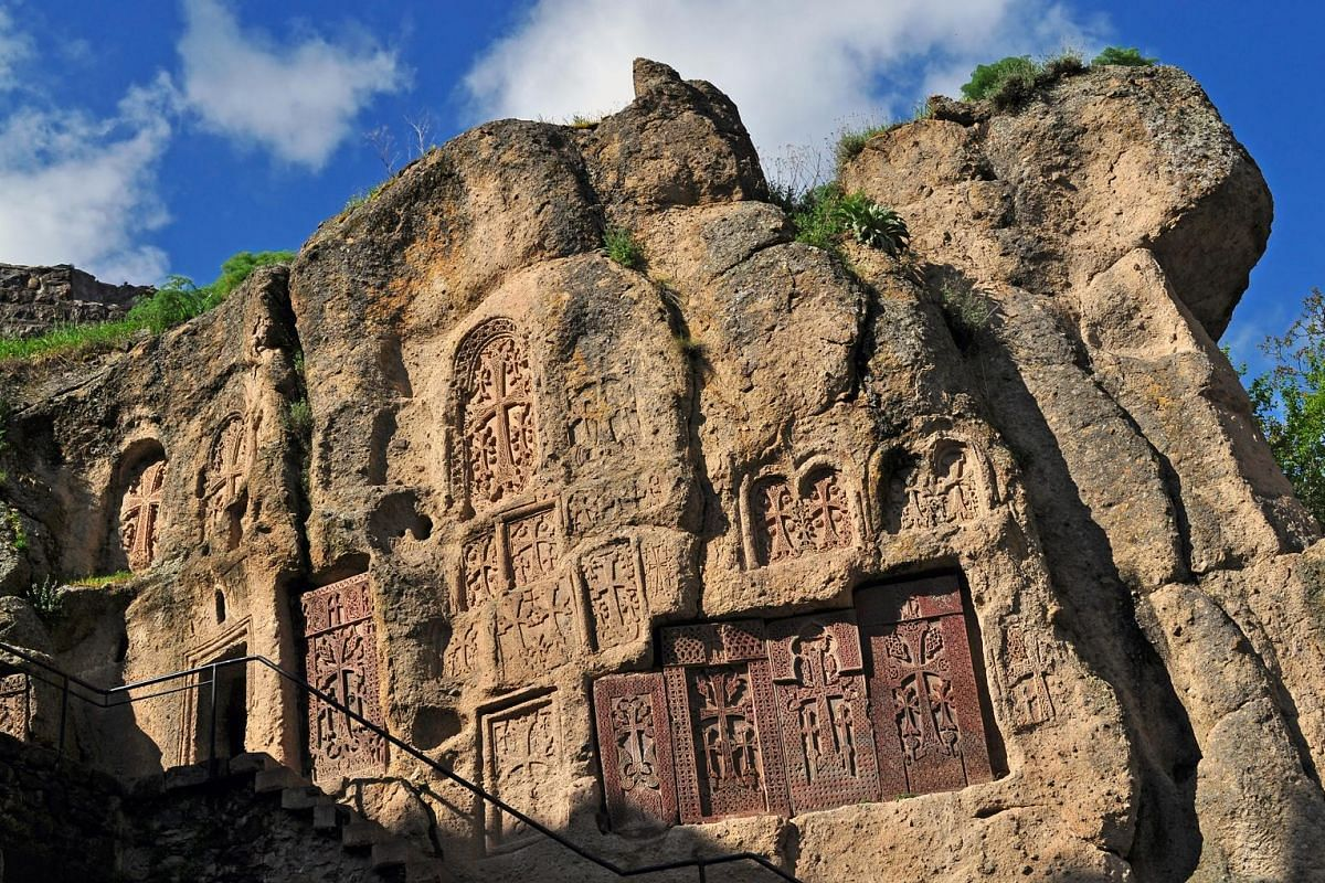Part of the Geghard monastery (above) in Armenia is carved out of the adjacent mountain and the Sevanavank Monastery overlooks Lake Sevan.