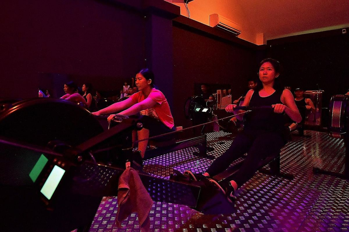 Clara Lock (right) at Row Revolution's Dynamic Row class, which includes core exercises and teamwork.