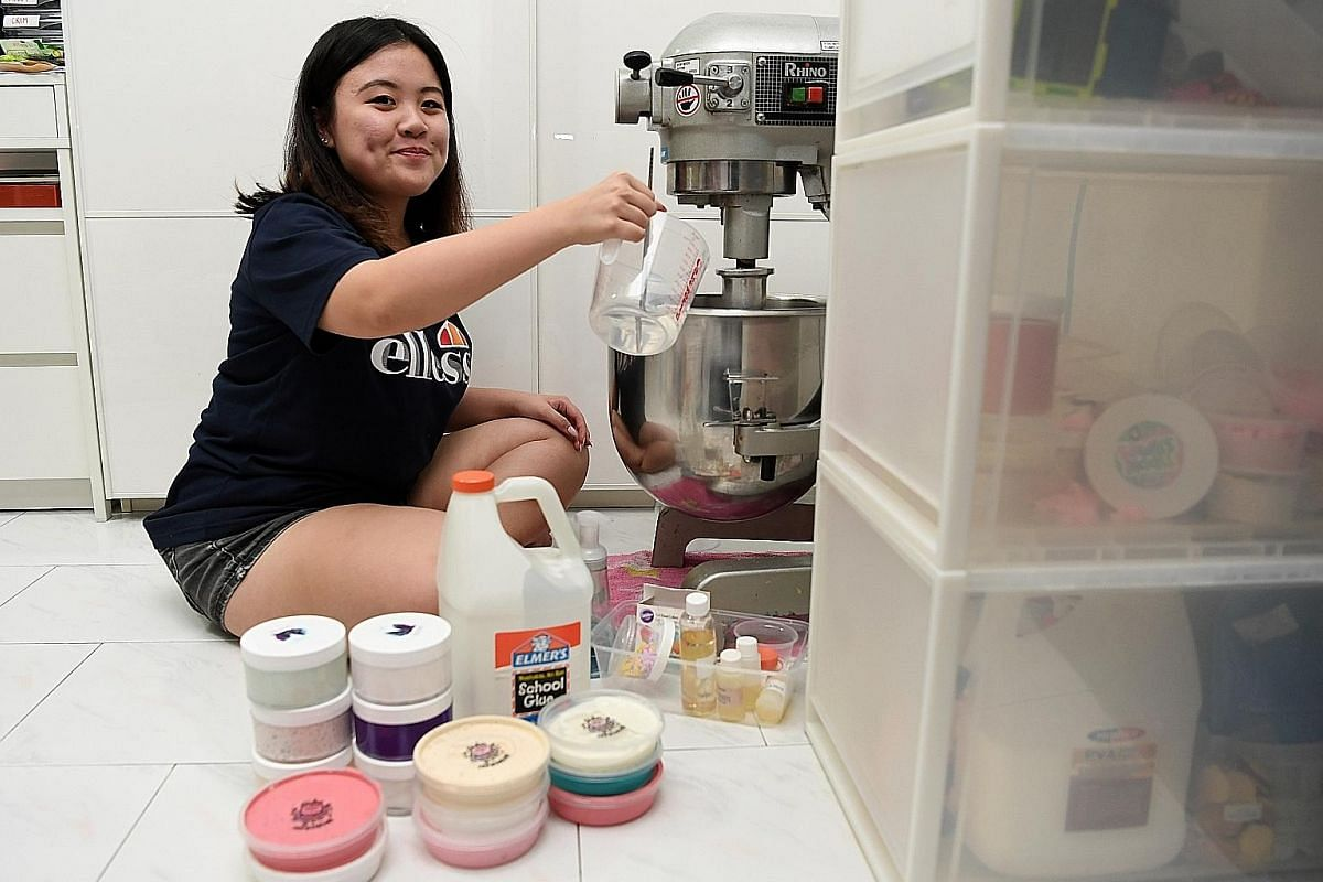 Polytechnic student Adele Lim using a commercial machine to do the slime mixing. She earned a profit of $2,000 last Saturday at a bazaar, selling over 30 types of slime priced at $7.50 a tub.