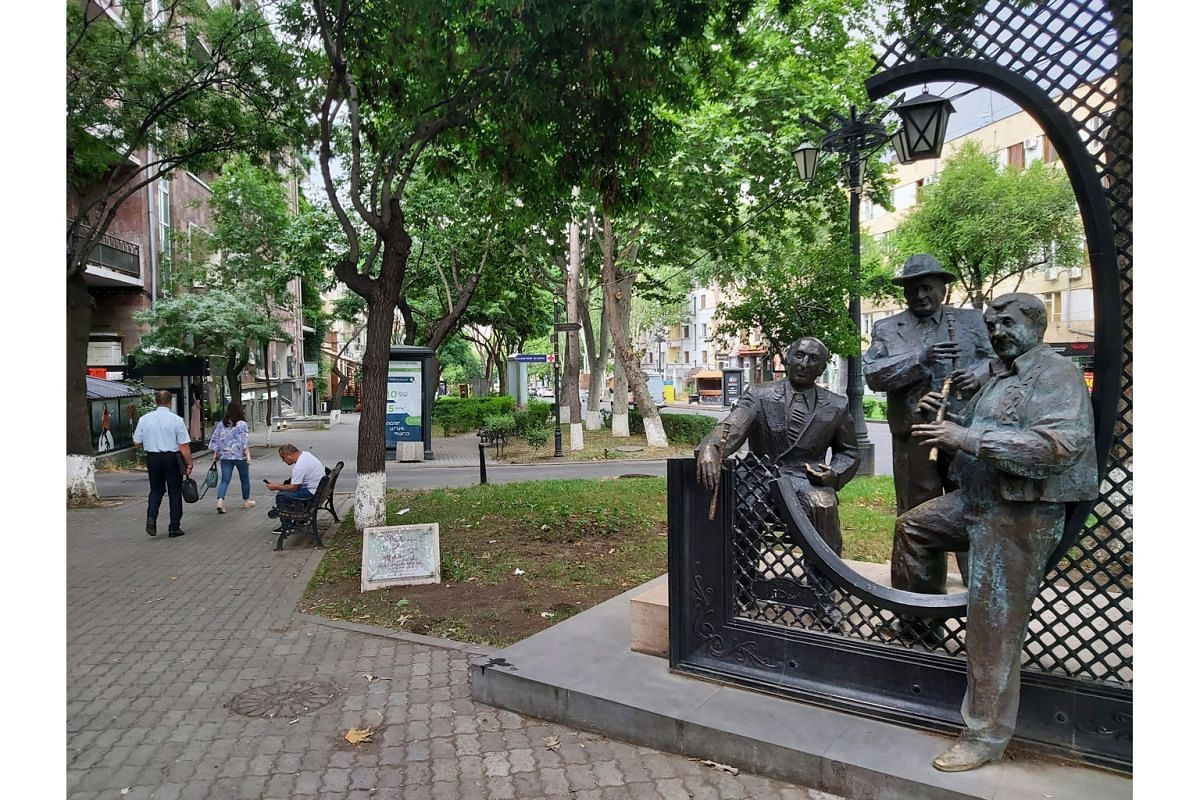 A street sculpture of Jivan Gasparyan, Vatche Hovsepyan and Levon Madoyan, who are masters of the duduk, an Armenian woodwind instrument made of apricot wood.
