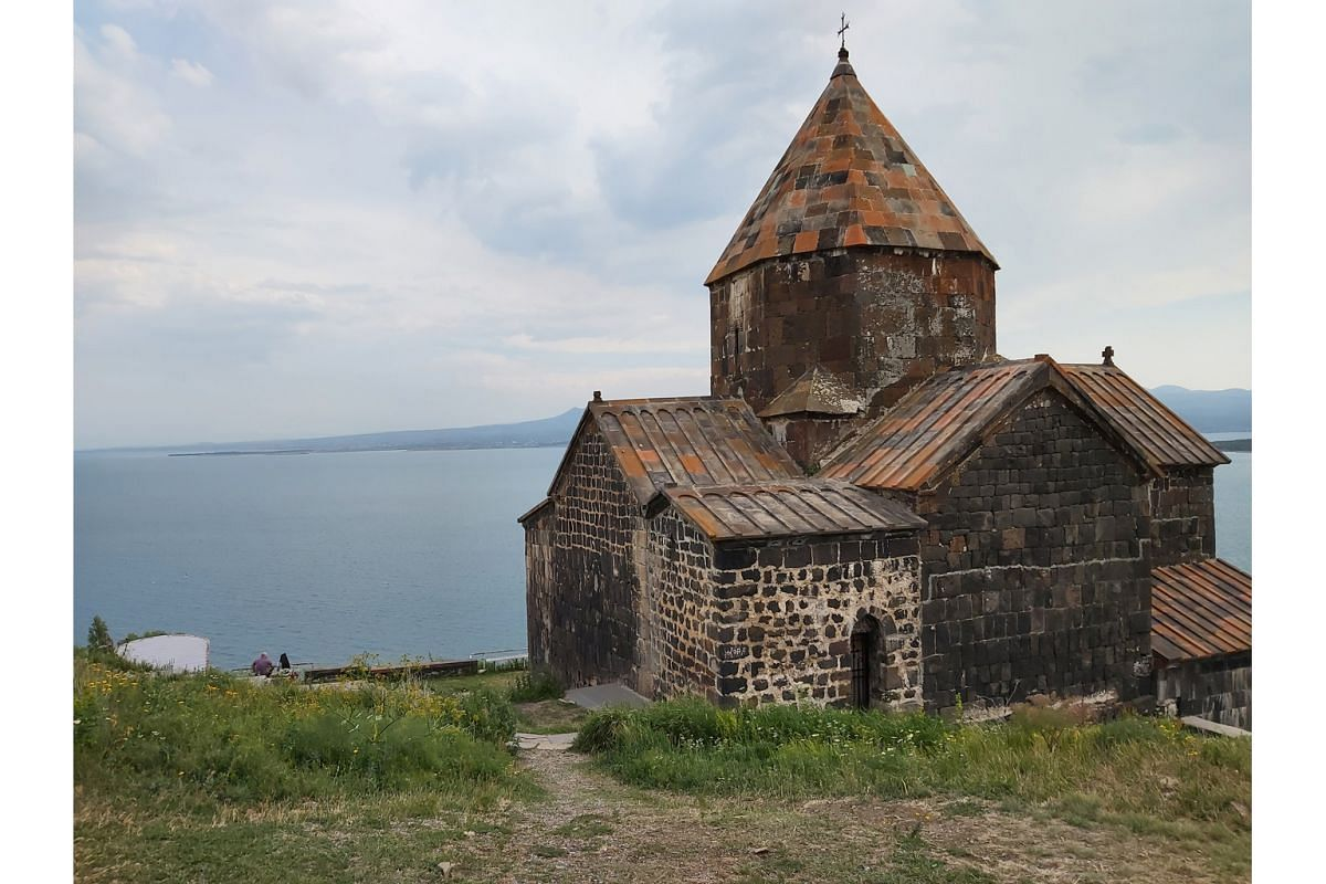 Part of the Geghard monastery in Armenia is carved out of the adjacent mountain and the Sevanavank Monastery (above) overlooks Lake Sevan.