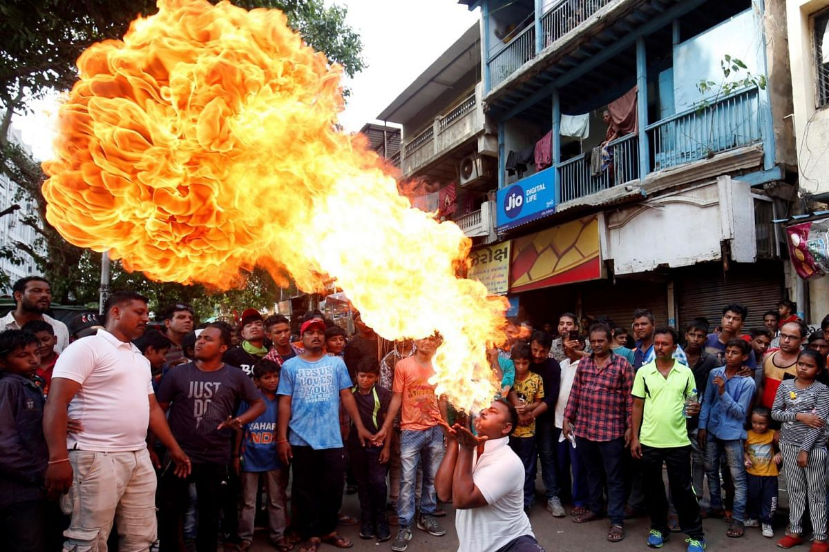 A Hindu devotee performs a stunt with fire during a rehearsal ahead of the annual Rath Yatra, or chariot procession, in Ahmedabad, India, on June 30, 2019.