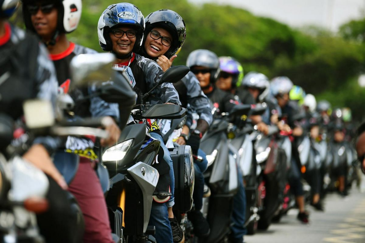 Motorcyclists taking part in a charity ride at a carpark near Kallang Leisure Park in Singapore, on June 30, 2019.