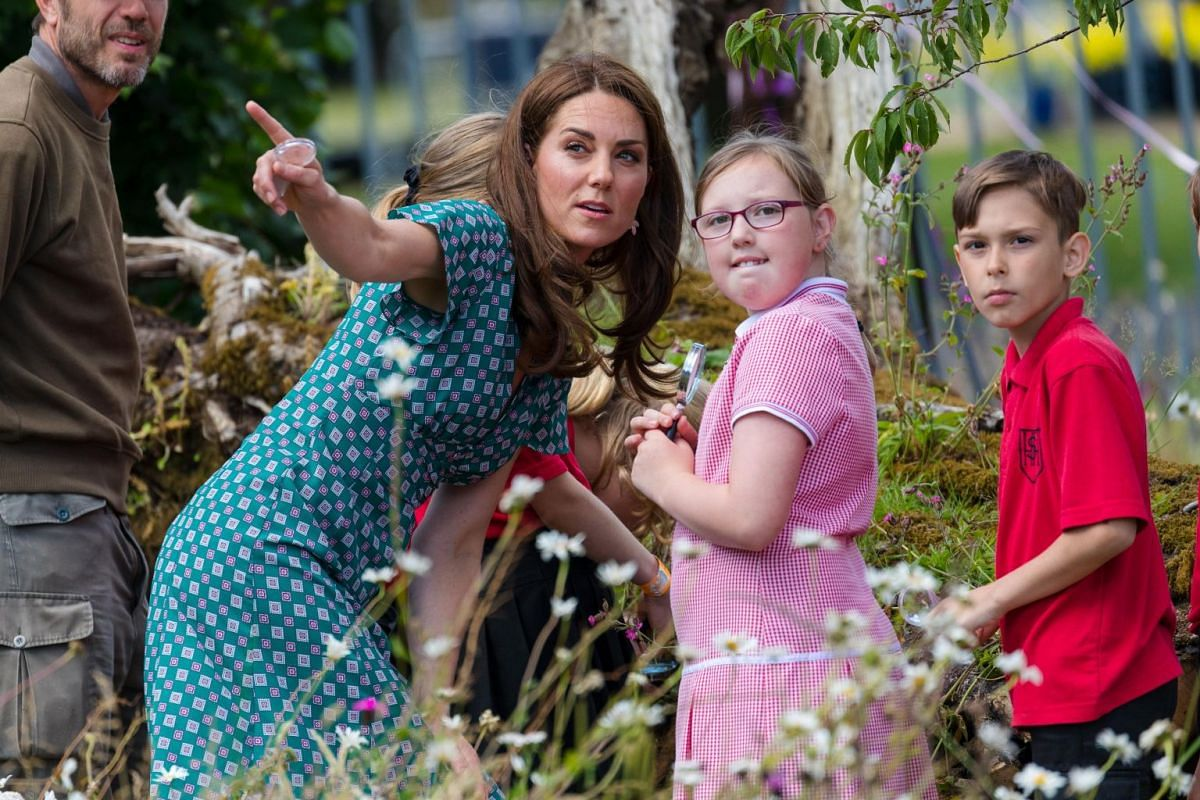 Britain's Catherine, Duchess of Cambridge, visits The Back To Nature Garden with children during the press day of the RHS Hampton Court Palace Garden Festival in London, Britain, on July 1, 2019.