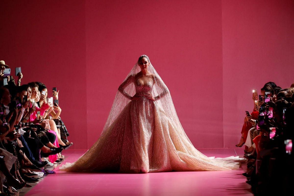 Araya A. Hargate presents a wedding dress creation by designer Georges Hobeika as part of his Haute Couture Fall/Winter 2019/20 collection show in Paris, France, on July 1, 2019.