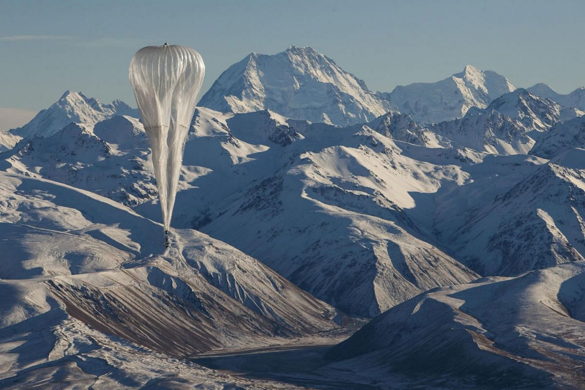 A Loon Internet balloon, carrying solar-powered mobile networking equipment, flies over rugged terrain in New Zealand, in a photo released on June 27, 2019.