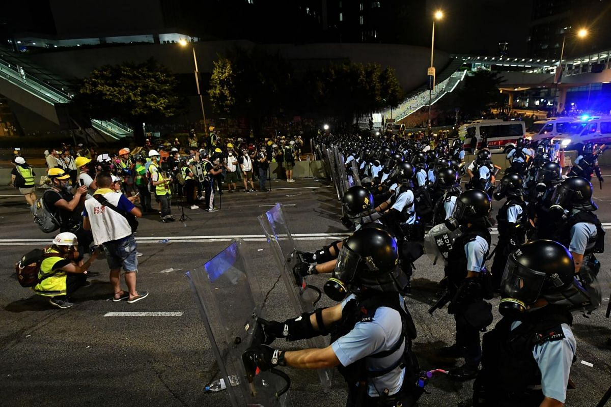 Police in riot gear on Harcourt Road between Admiralty Centre and Central Government Complex after midnight on July 2, 2019.