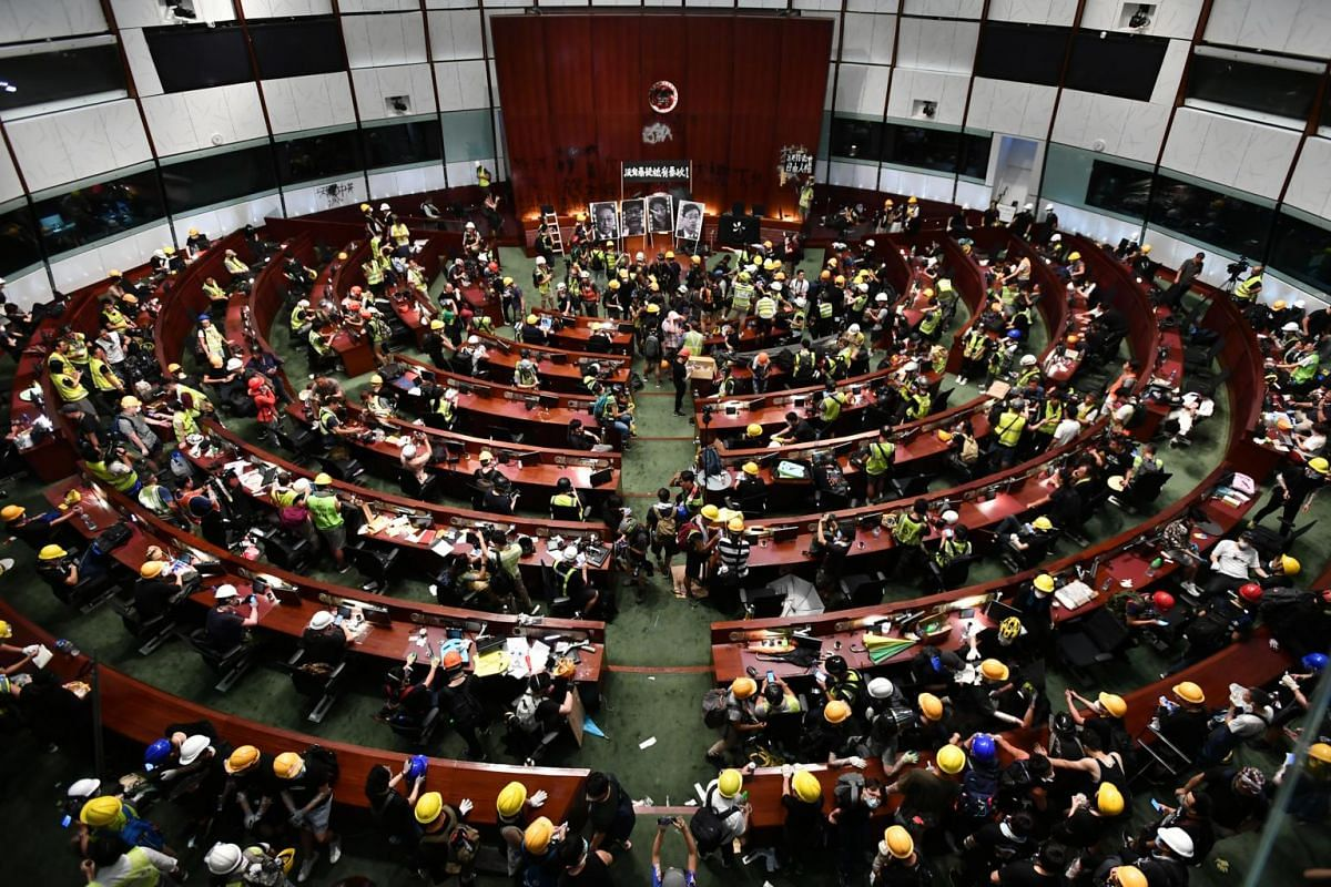 Protesters and media inside the chamber of the Legislative Council complex on July 1, 2019.