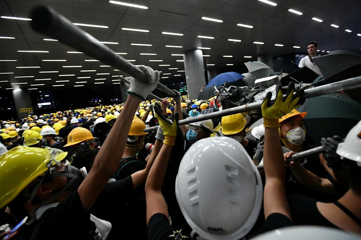 Protesters forming a human chain to bring tools into the Legislative Council complex on July 1, 2019.