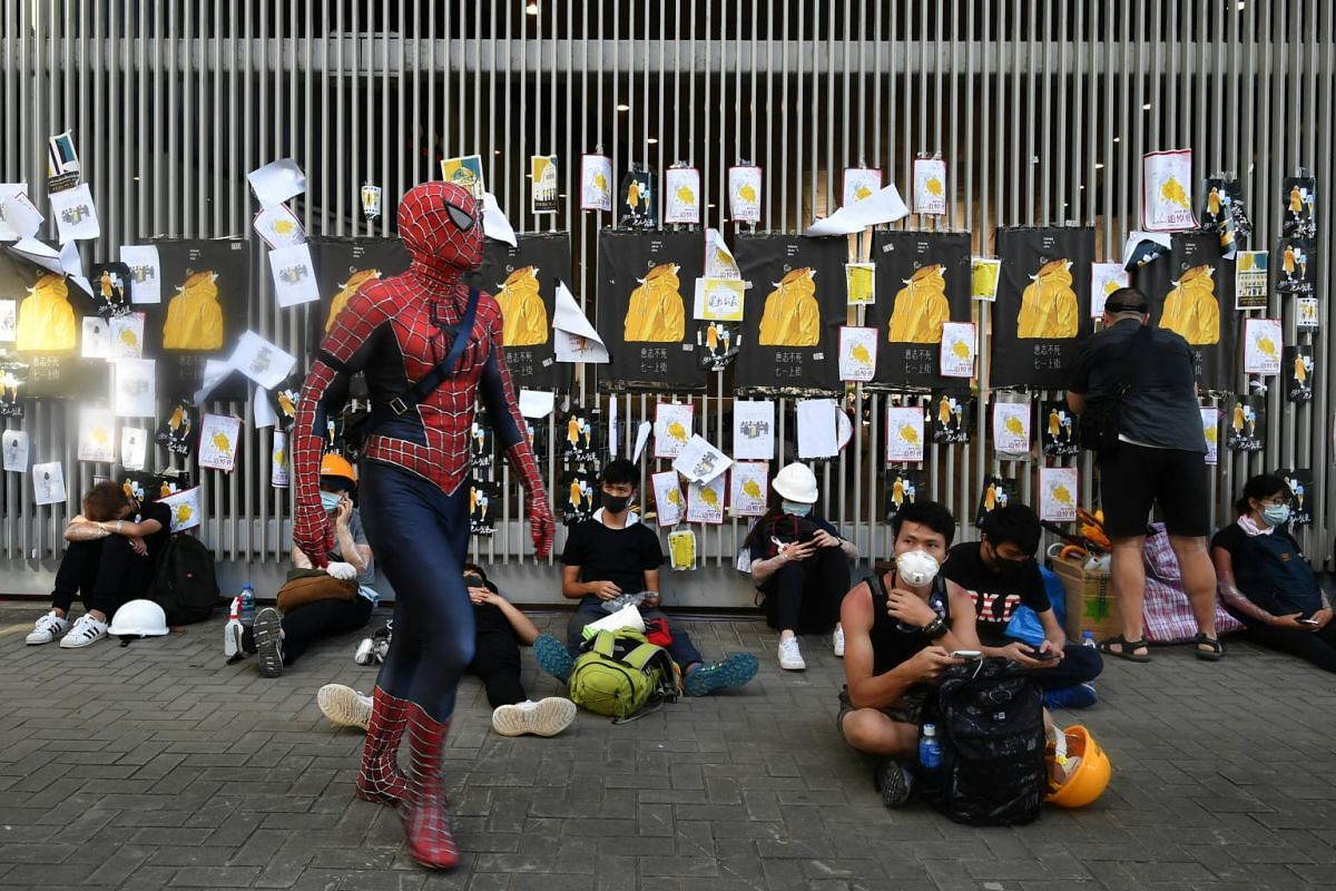 A man in Spider-Man costume walking outside the Legislative Council Complex in Hong Kong on July 1, 2019.