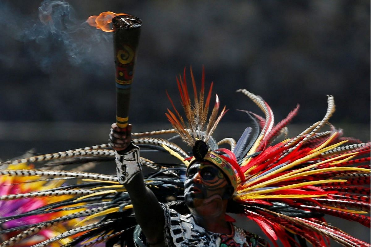 A dancer takes part in a ceremony in Teotihuacan, Mexico, on July 2, 2019, to light the torch for the 2019 Pan American Games. The games will be held in Lima, Peru.