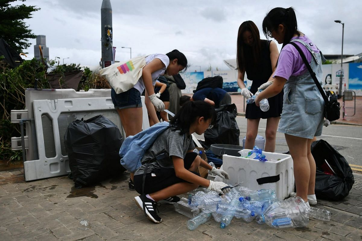 Volunteers cleaning up outside the Legislative Council Complex, on July 2, 2019.