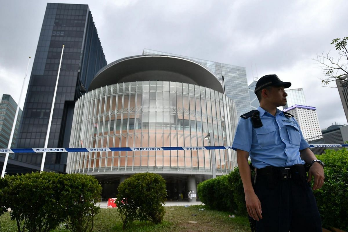 Police standing guard in front of the Legislative Council Complex, on July 2, 2019.