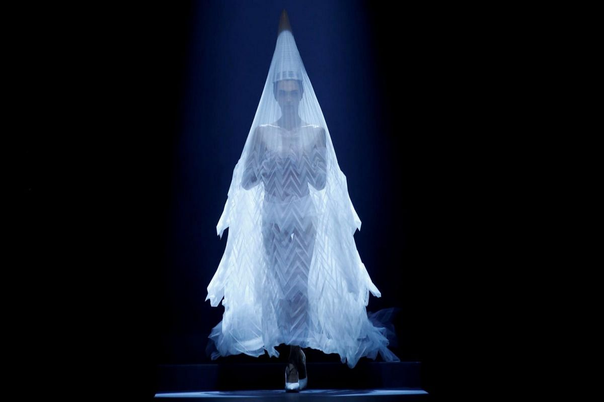 A model presents a wedding dress creation by designer Jean Paul Gaultier as part of his Haute Couture Fall/Winter 2019/20 collection show in Paris, France, on July 3, 2019.