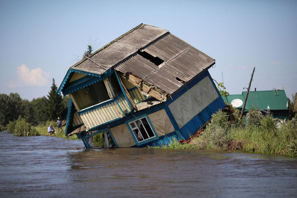 A destroyed house is seen in the flood-affected town of Tulun in Irkutsk Region, Russia, on July 1, 2019.