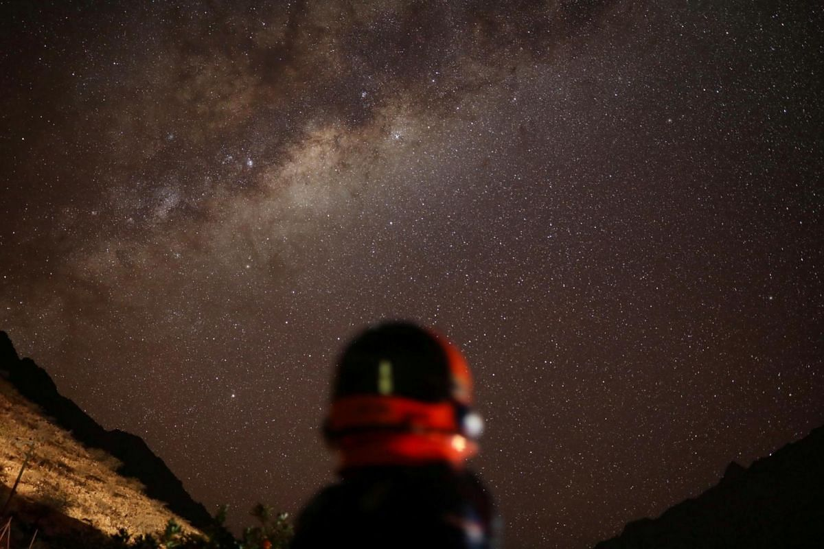 Ricardo Barriga, 10, who wants to be an astronomer, poses for a photograph while wearing an astronaut's outfit before a total solar eclipse, in Valle Luz de la Luna, Chile, on July 1, 2019.