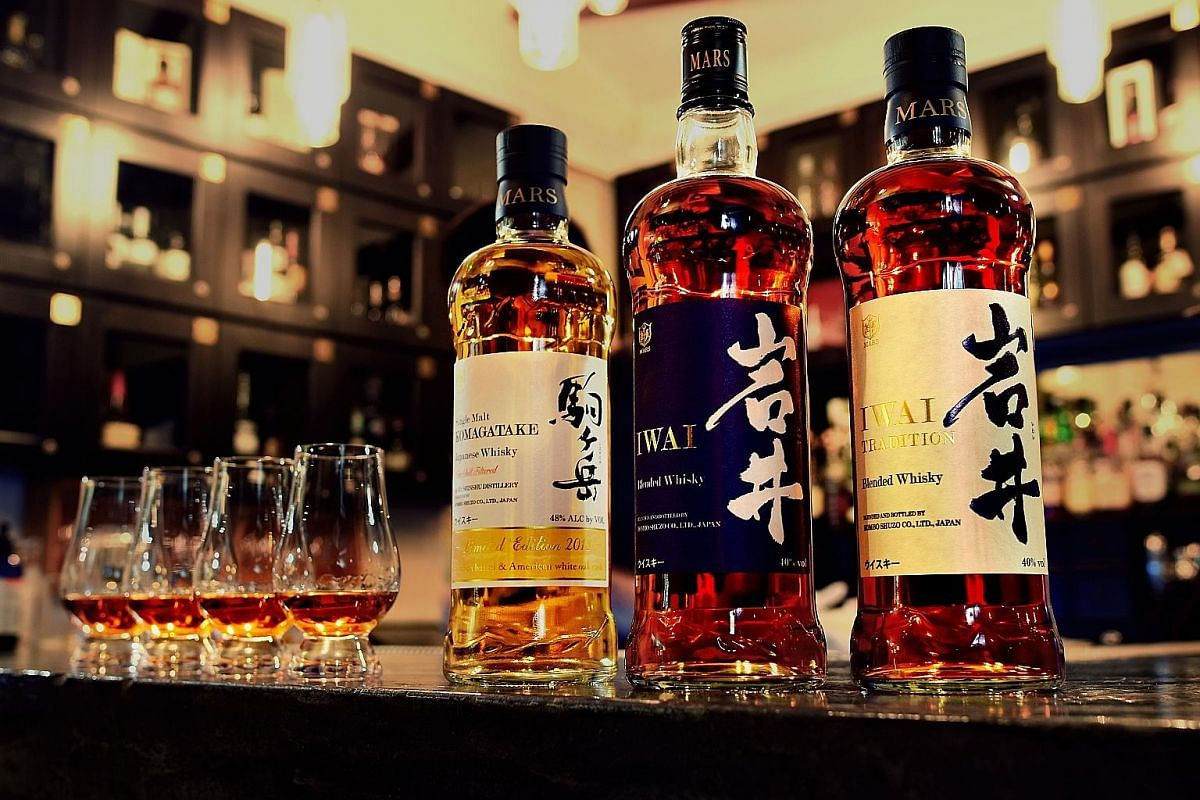 Some of the spirits produced by Mars Whisky and Mr Hajime Kunai, director of Mars Shinshu Distillery in Nagano prefecture.