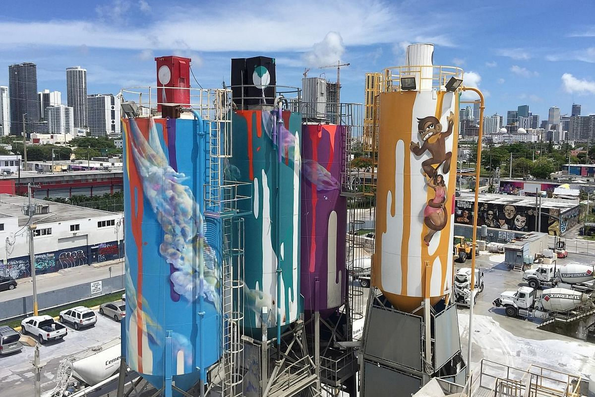 """Four old, 23m-high silos have been turned into giant art-covered spray paint cans by local artist Danny """"Krave"""" Fila."""