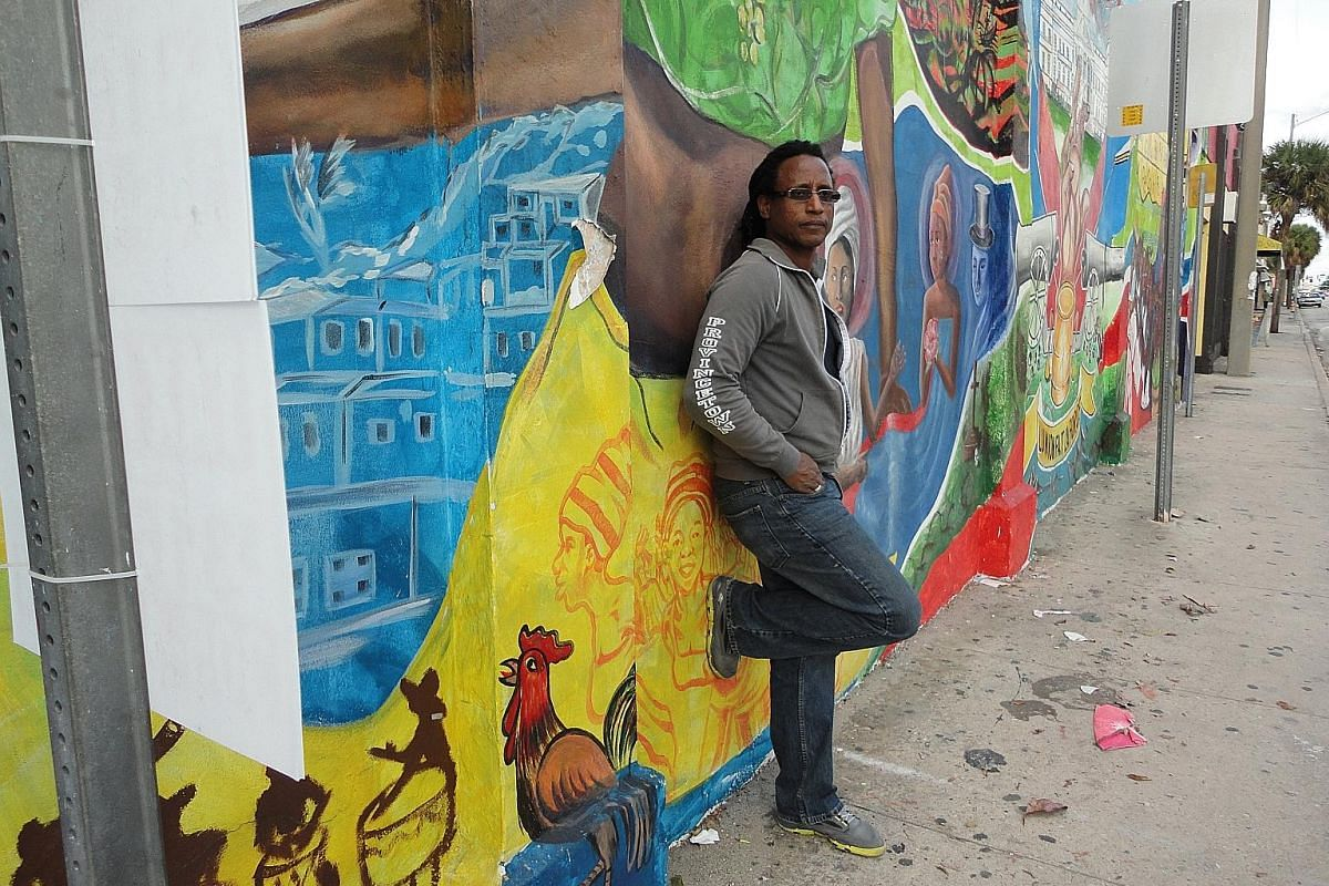 Photographer Carl Juste is a strong champion of the arts in Little Haiti, which has many walls of concrete blocks covered in murals.