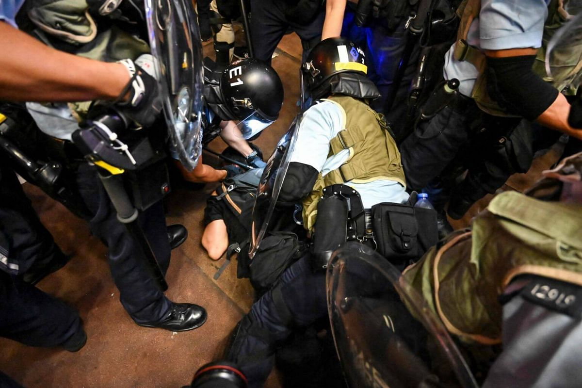 Police arrest protesters during a clash in the Mong Kok district in Kowloon after a march to the West Kowloon rail terminus in Hong Kong, on July 7, 2019.