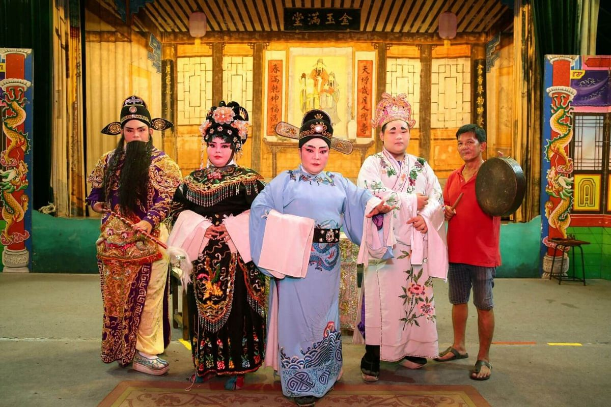 Sin Ee Lye Heng's troupe leader Tina Quek (centre) with (from left) son Ang Wei Hao, daughter Christine Ang, son Ang Wei Li and husband Ang Chwee Bok before a performance for Lord Cheng Huang's birthday celebration at Lorong Koo Chye Sheng Hong Templ