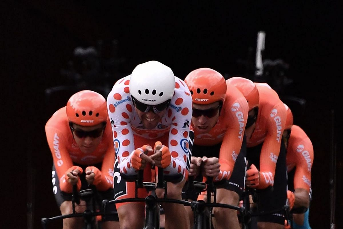 Belgian rider Greg Van Avermaet (front) wearing the best climber's polka dot jersey and teammates of Poland's CCC Team cycling team compete in the second stage of the 106th edition of the Tour de France cycling race, a 27.6km team time-trial in Bruss