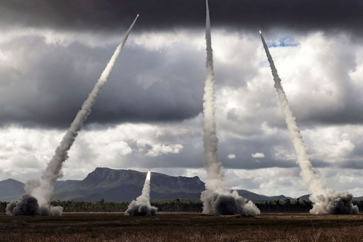 A handout photo made available by the Australian Department of Defence on July 10, 2019, shows United States Army and United States Marine Corps perform a live fire of M142 High Mobility Artillery Rocket Systems at Shoalwater Bay Training Area in Que