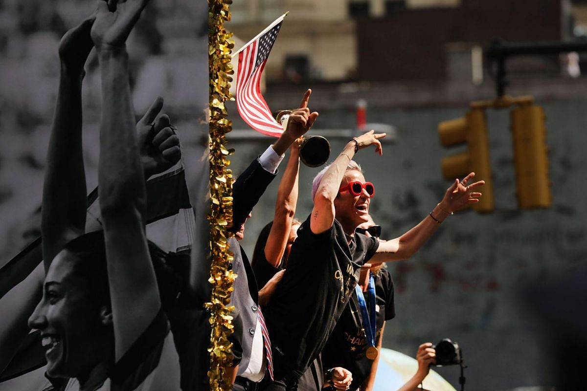 Megan Rapinoe celebrates while riding on a float during the US Women's National Soccer Team Victory Parade through the Canyon of Heroes on July 10, 2019, in New York City. PHOTO: GETTY IMAGES/AFP