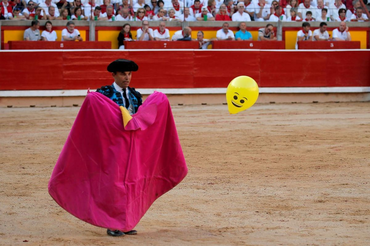 An assistant bullfighter watches a balloon during a bullfight at the San Fermin festival in Pamplona, Spain, July 9, 2019. PHOTO: REUTERS