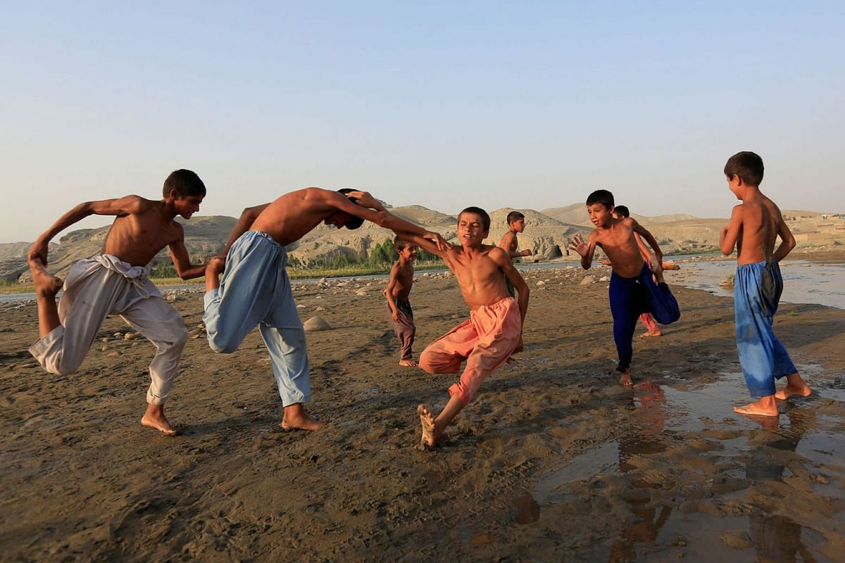 Afghan boys play on the outskirts of Jalalabad city, Afghanistan, on July 10, 2019. PHOTO: REUTERS