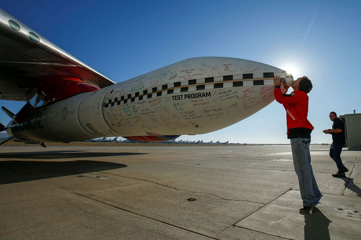 Virgin Orbit's chief engineer Kevin Sagis kisses the tip of a test rocket underneath the wing of a modified Boeing 747 jetliner prior to its takeoff and drop test of its high-altitude launch system for satellites from Mojave, California, US, on July