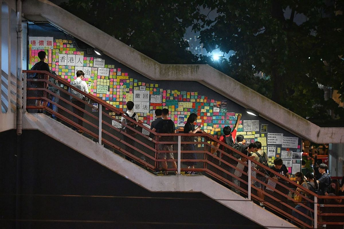 A 'Lennon Wall' of sticky notes and posters on an overhead bridge in Hong Kong on July 11, 2019. PHOTO: THE STRAITS TIMES/CHONG JUN LIANG