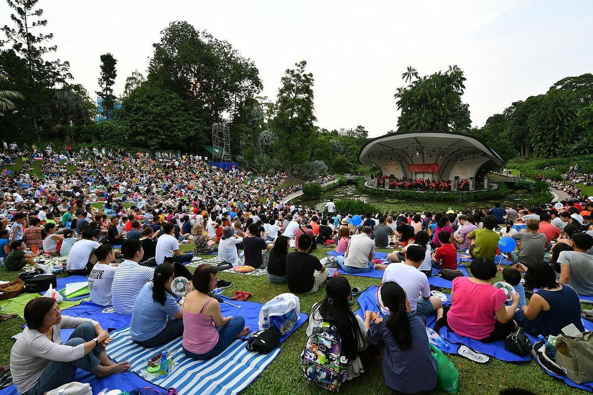 The packed lawn comprising more than 12,000 people enjoying a mix of classics and family favourites played by the Singapore Symphony Orchestra, led by associate conductor Joshua Tan. The pieces include Rossini's Overture To The Barber Of Seville, Sho