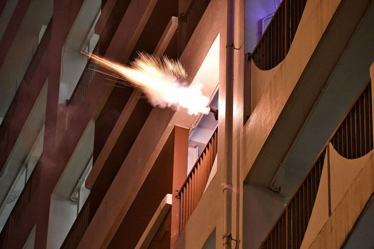 Hong Kong police firing at protesters from a building on July 28, 2019.
