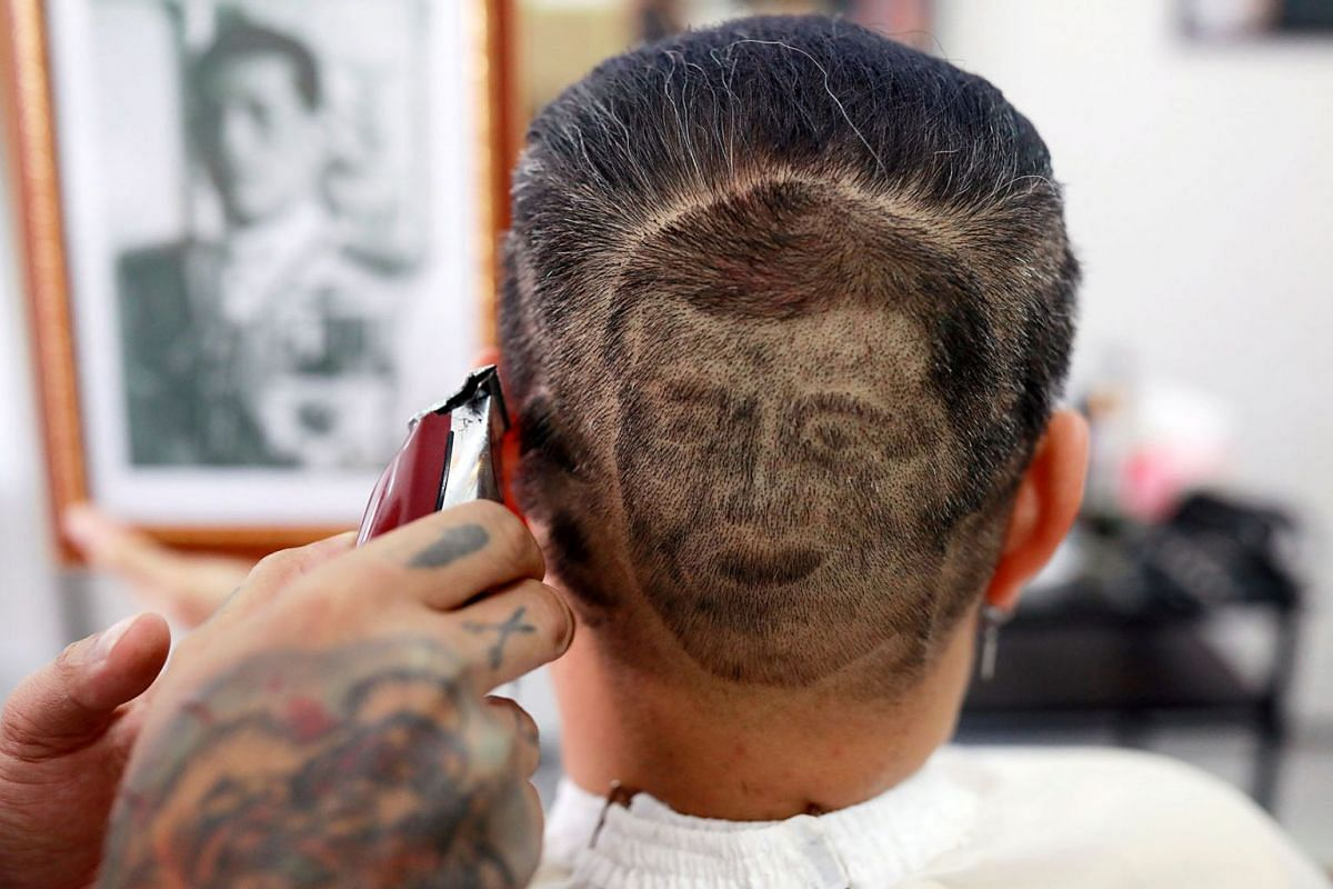 Mitree Chitinunda gets a haircut depicting the face of Thai King Maha Vajiralongkorn, to mark the King's 67th birthday, at a barbershop in Bangkok, Thailand, on July 28, 2019.