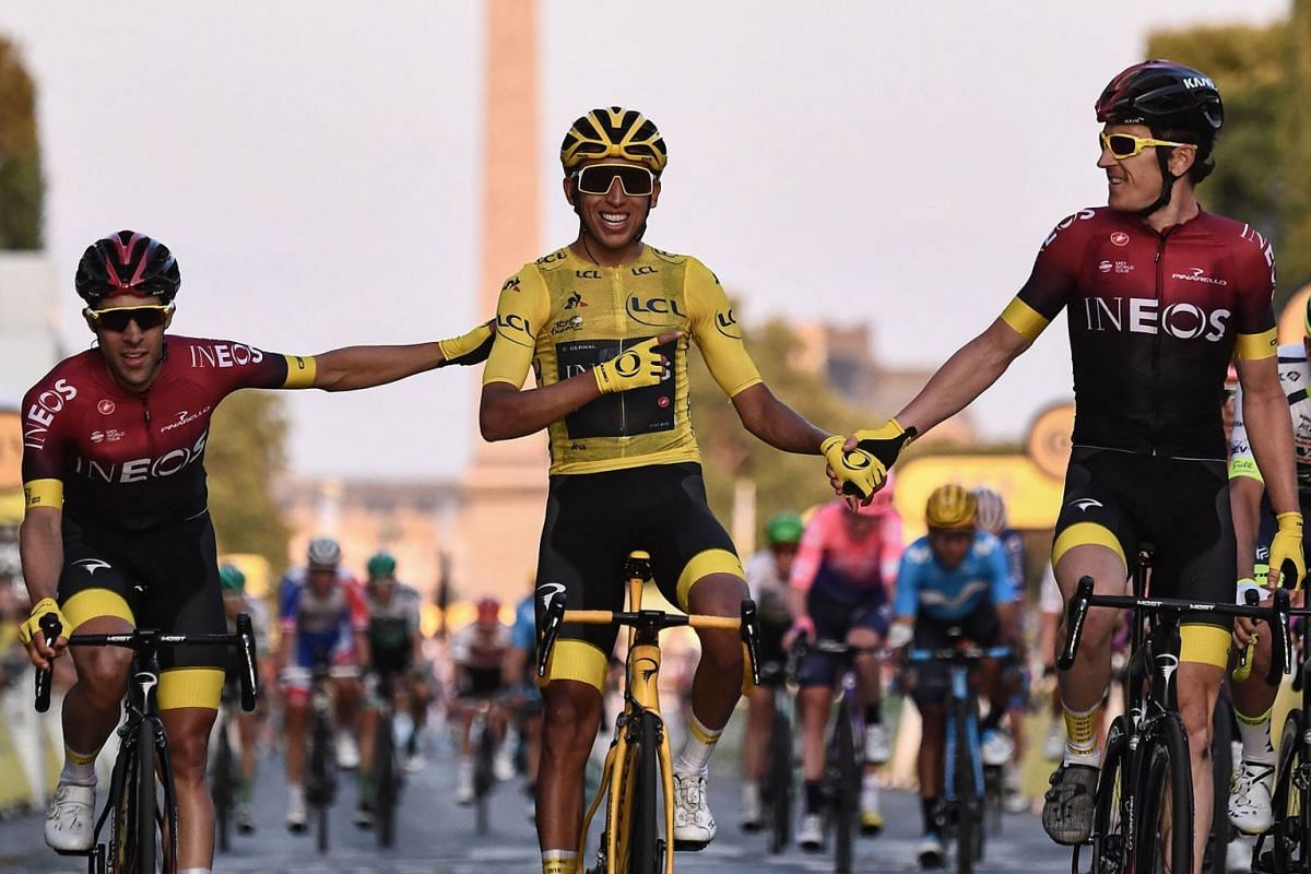 Spain's Jonathan Castroviejo (left) and Britain's Geraint Thomas (right) congratulate Colombia's Egan Bernal (centre), wearing the overall leader's yellow jersey, as he celebrates his victory on the finish line of the 21st and last stage of the 106th