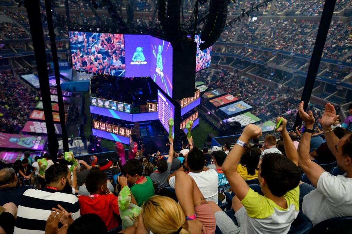 Fans cheer during the final of the Solo competition at the 2019 Fortnite World Cup on July 28, 2019.