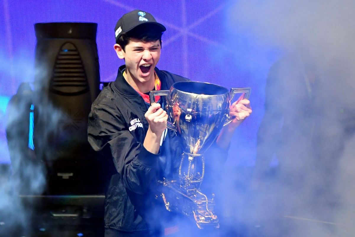 American teenager Kyle Giersdorf celebrates with the trophy after winning the final of the Solo competition at the 2019 Fortnite World Cup on July 28, 2019.