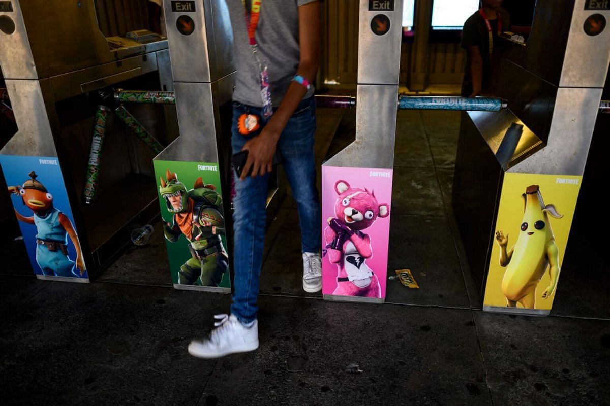 Pictures of Fortnite characters adorn the gates at a subway station near Arthur Ashe Stadium in New York on July 28, 2019, after the Solo competition at the 2019 Fortnite World Cup.