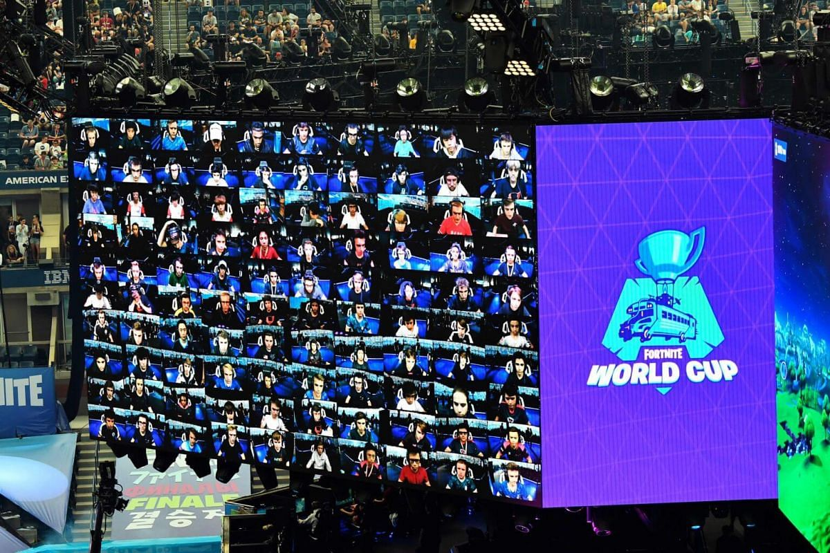 Players appear on screen during the final of the Solo competition at the 2019 Fortnite World Cup at the Arthur Ashe Stadium in New York on July 28, 2019