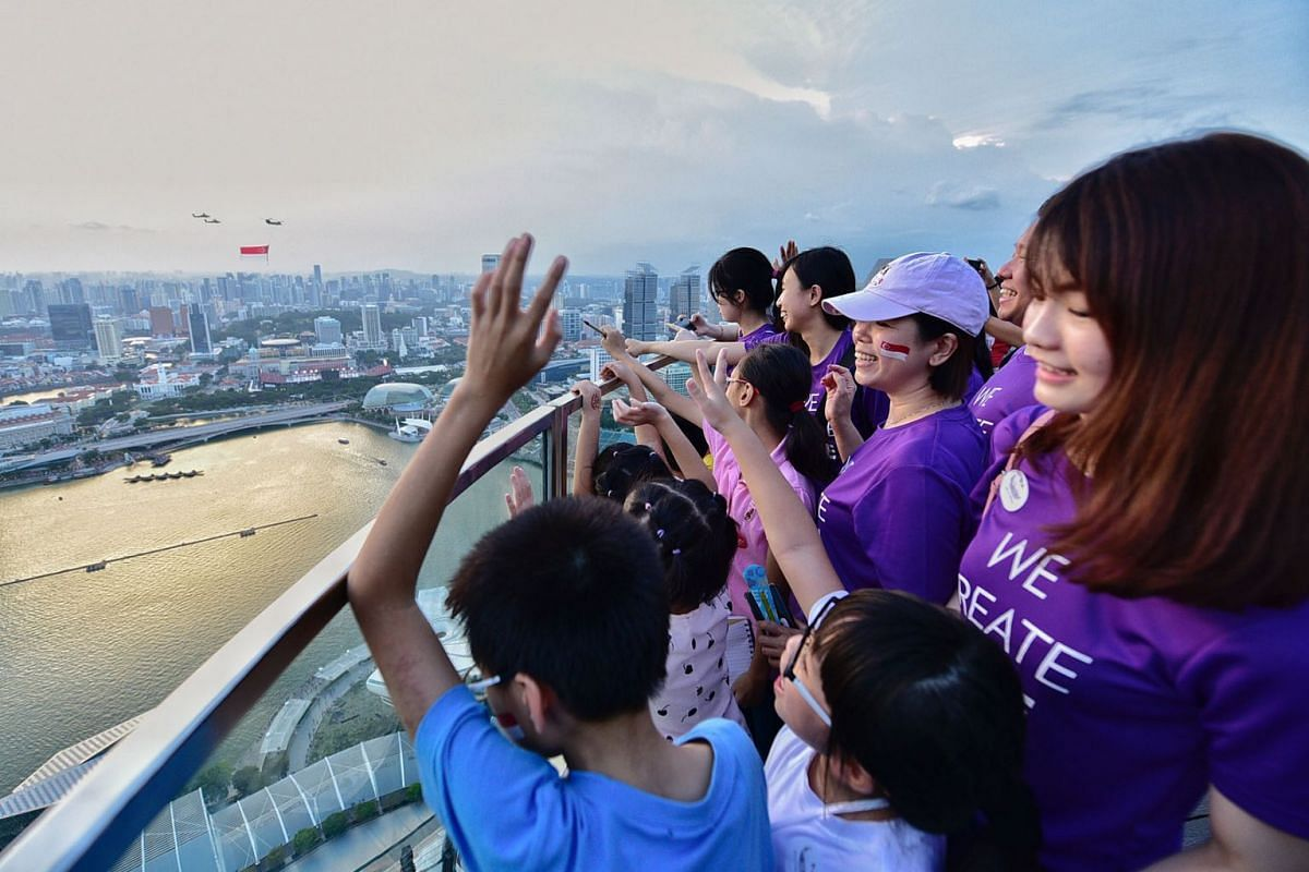60 children and caregivers from SHINE Children and Youth Services, and The Salvation Army enjoyed an exclusive experience to watch the NDP preview state-flag fly past at the Sands SkyPark Observation Deck on 27 July 2019 . This is part of the Sands f