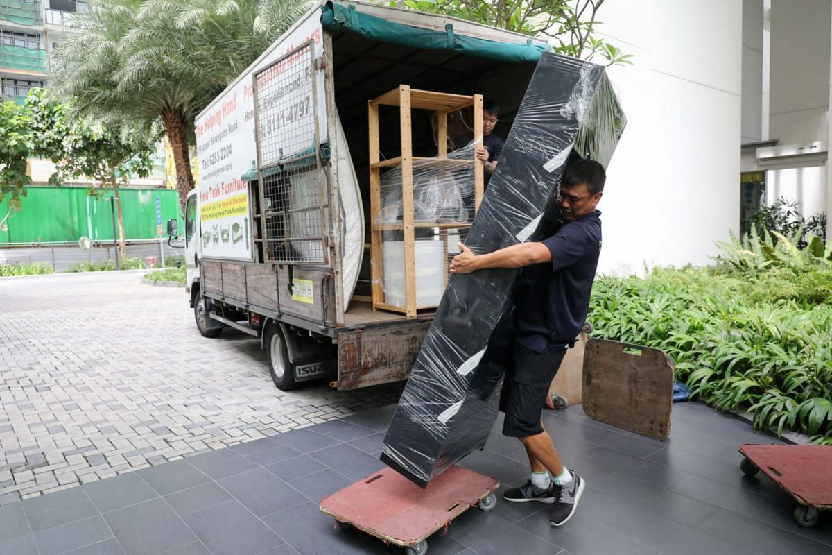 """Mr Kang unloads a bed from the lorry. He says the work can be back-breaking. At age 56, he is acutely aware that he cannot go on doing the job as he gets older. He says: """"For someone like me, what else can I do? Another job I can think of is to wor"""