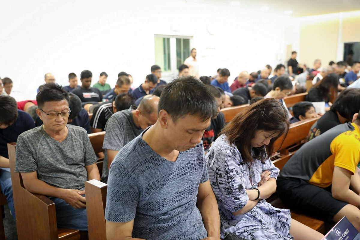 Mr Kang and his wife, sales associate Christine Lim, 51, attend service on family day at The Helping Hand, which opens its premises every two months for family members to have dinner with residents as a form of support.