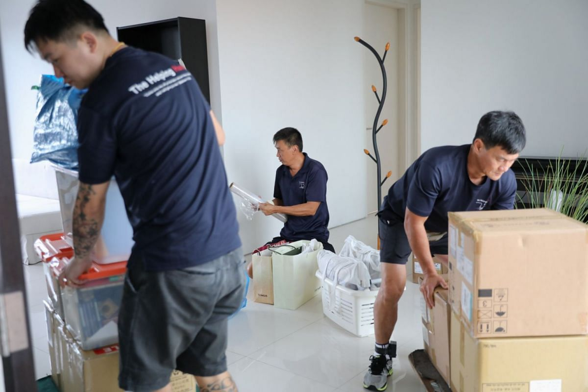 The team gets to work moving boxes and furniture. The client, Ms Doreen Quiaoit, 34, said she decided to engage The Helping Hand as it came highly recommended by the expatriate community.