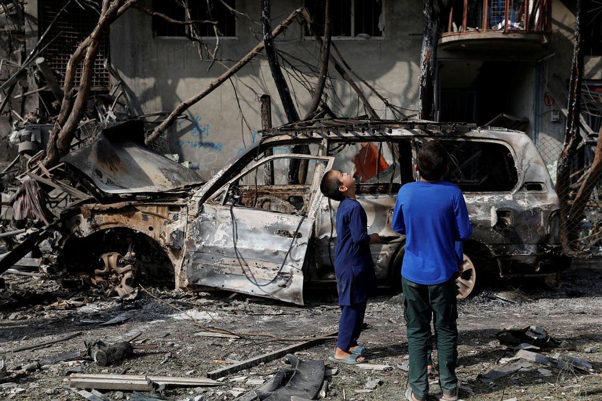 Afghan boys look the site of Sunday's attack in Kabul, Afghanistan July 29, 2019. PHOTO: REUTERS