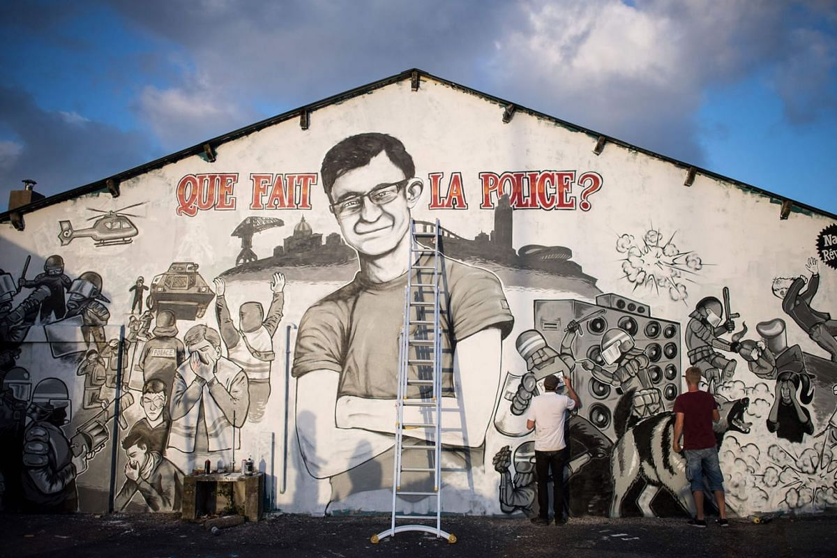 Graffiti artists work on a mural depicting an image of a missing man called Steve, standing crossed armed with a message that reads 'What is the police doing ?' on July 29, 2019 in the western French city of Nantes. PHOTO: AFP