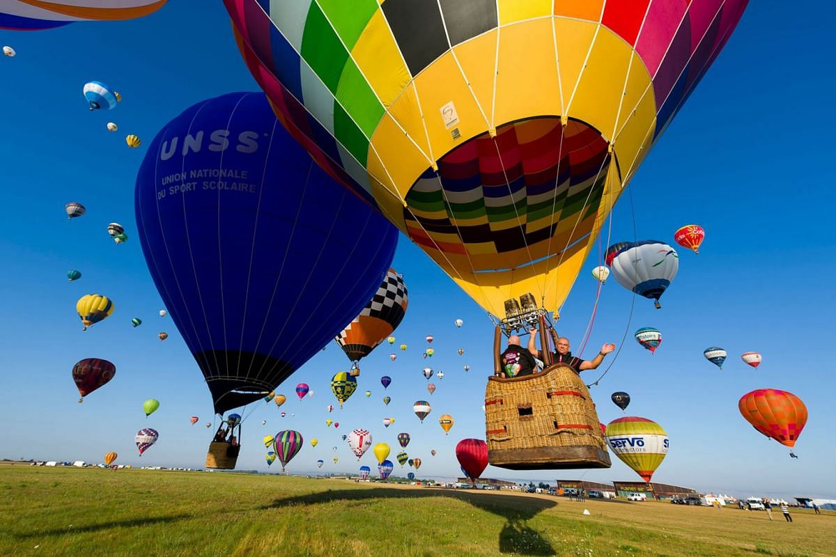More than 400 hot air-balloons take off from the Chambley-Bussieres airbase, eastern France, during a missed attempt to break the simultaneous air-balloon take off world record on July 29, 2019 in Hagéville, as part of the international air-balloon