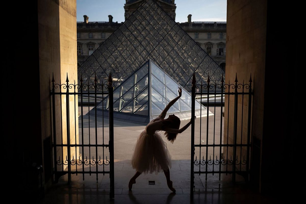 A ballerine dances at the Louvre pyramid on July 25, 2019 in Paris as a heat wave hits the French capital. PHOTO: AFP