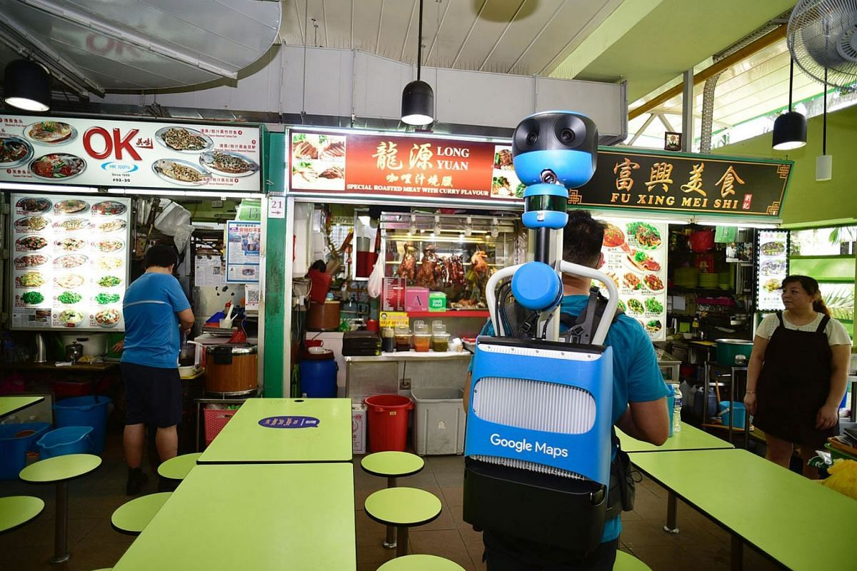 Street View Trekker operator Keith Lee, 24, capturing indoor imagery at Dunman Food Centre on July 31, 2019. All 114 hawker centres here will have their individual stalls marked with separate pins on the Google Maps app by early next year, showing th