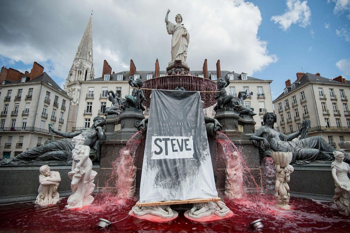 A red dye had been displayed in the fountain of the Place Royale on July 30, 2019 in the western French city of Nantes, a day after the body of Steve Maia Canico, a 24-year-old French man who disappeared a month ago after falling in the river followi